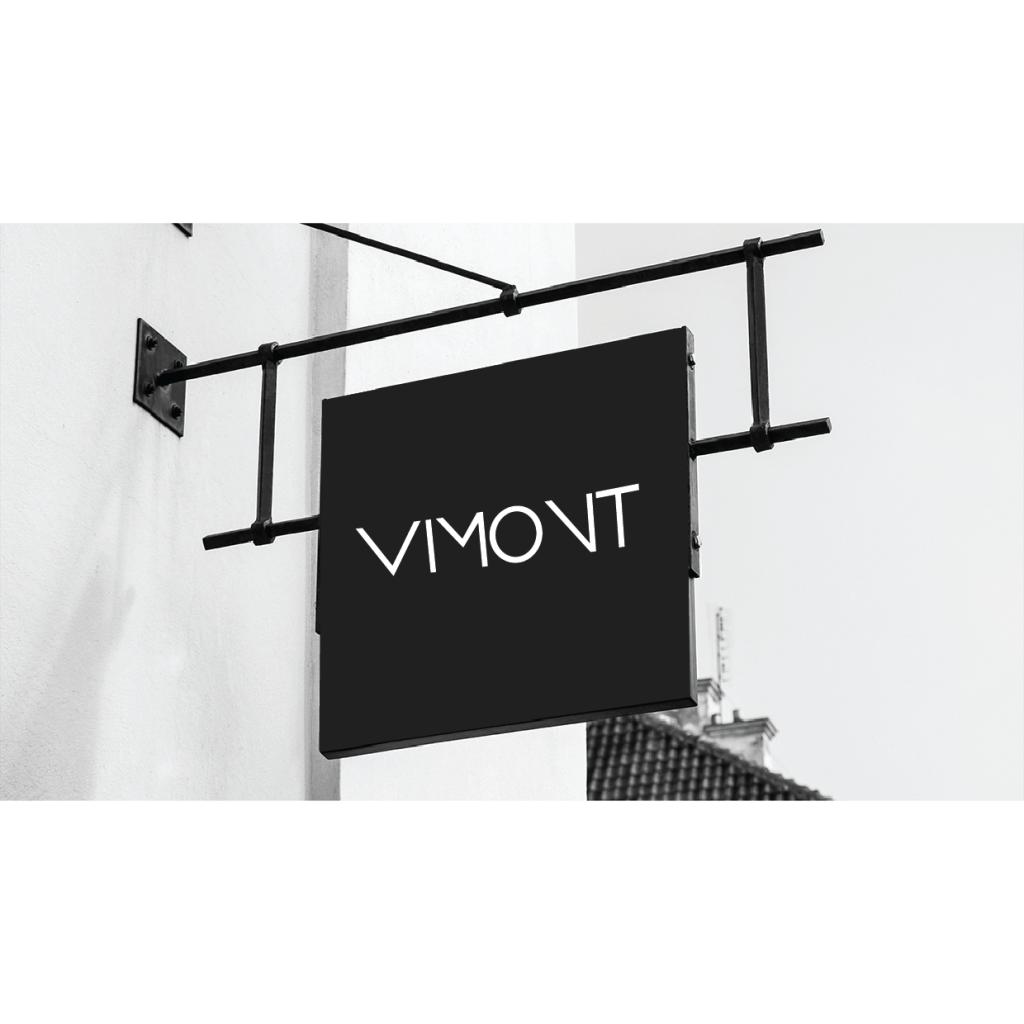Simulación de aplicación de logo en marquesina para negocio de ropa manejando blanco y negro.